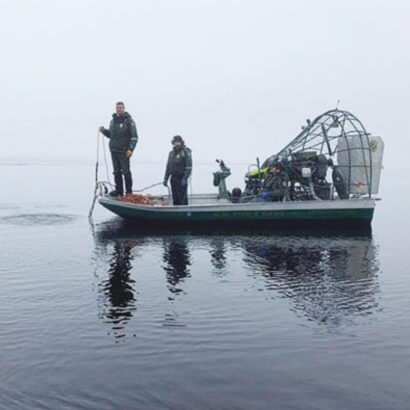 N.H. Fish & Game Department divers are seen heading out March 26 on Ossipee Lake to search for Sinead Lyons of Lowell, Mass. (Photo: N.H. Fish & Game)